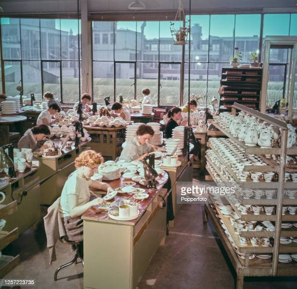 Pottery workers paint colours on to plates by hand at the new Wedgwood factory in Barlaston in the Staffordshire Potteries near StokeonTrent England...