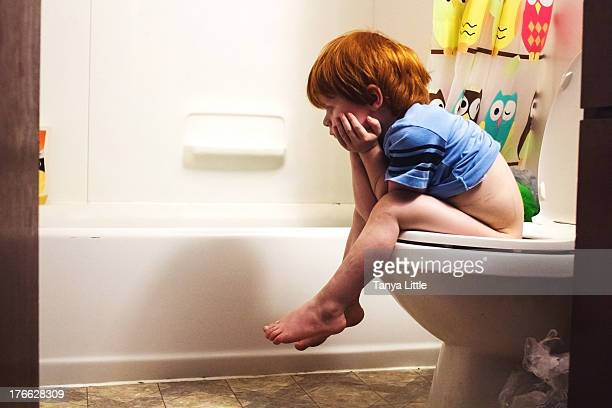 potty time - toilet bowl stock photos and pictures