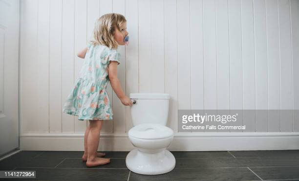 Girl peeing in the potty