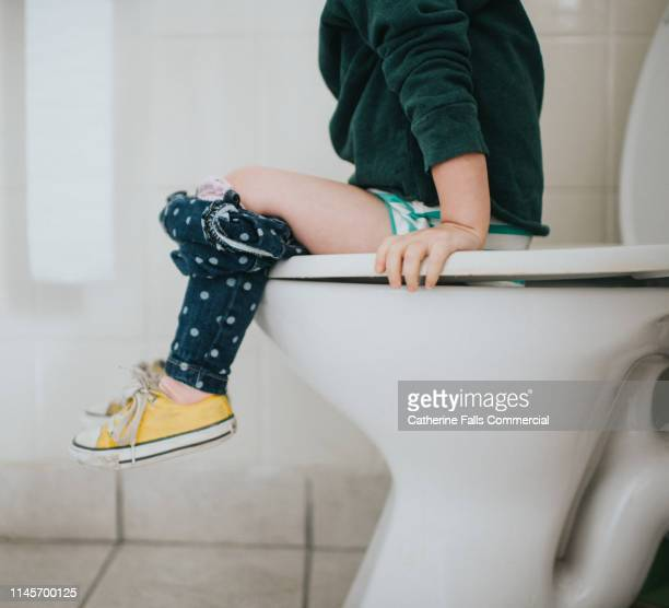 potty training - kids peeing stock pictures, royalty-free photos & images
