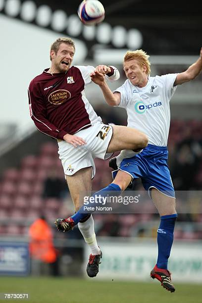 Poul Hubertz of Northampton Town challenges for the ball with Zak Whitbread of Millwall during the Coca Cola League One Match between Northampton...