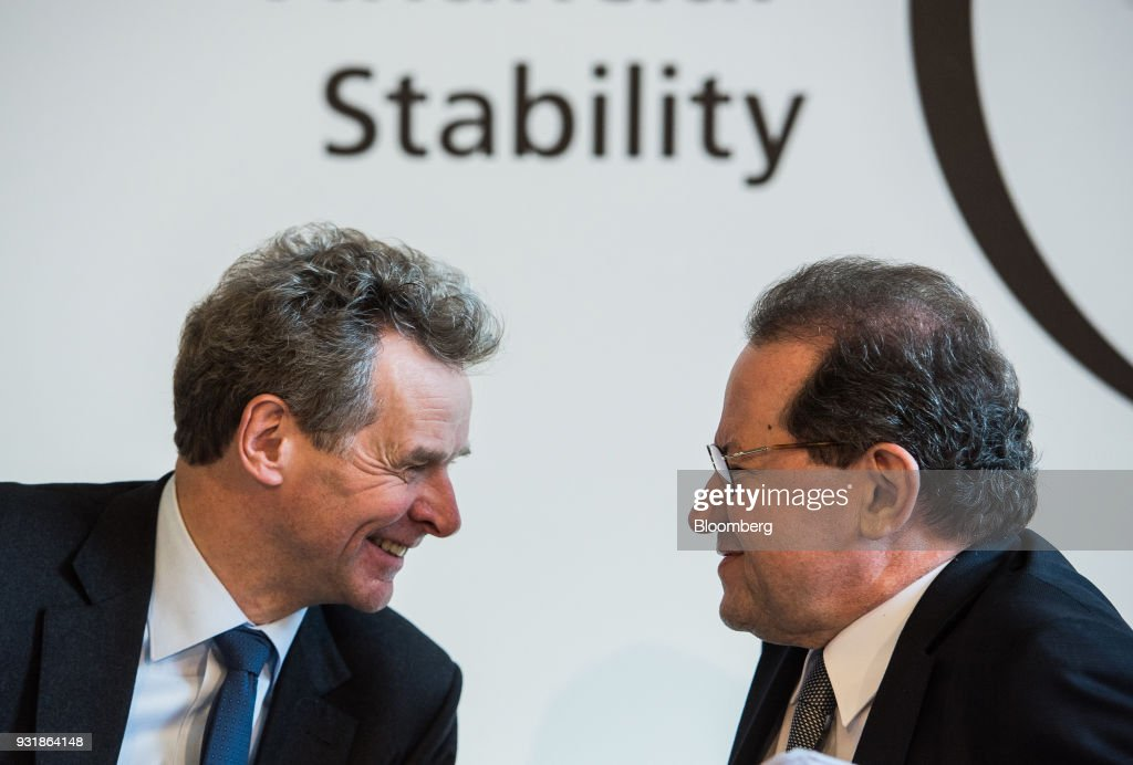 Poul Thomsen, director of the European department at the International Monetary Fund (IMF), left, speaks with Vitor Constancio, vice president of the European Central Bank (ECB), at the 'ECB and its Watchers' conference in Frankfurt, Germany, on Wednesday, March 14, 2018. European Central Bank President Mario Draghi said ECB policy makers wont rush to remove stimulus amid still-low inflation and warned that U.S. trade policies and a stronger euro could cloud the outlook. Photographer: Andreas Arnold/Bloomberg via Getty Images