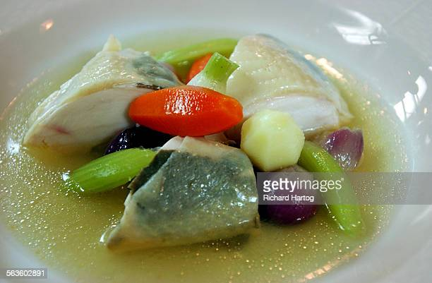 Poulet un Pot Chicken poached in a rich chicken broth with vegetables summer truffles