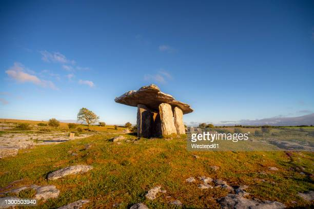 poulnabrone dolmen on landscape against clear blue sky during sunny day at clare, ireland - international landmark stock pictures, royalty-free photos & images