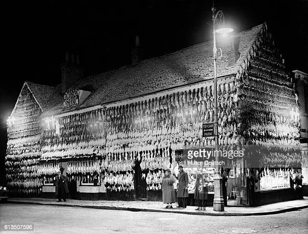 Poulterer shop in High Wycombe, England, is covered with fowl intended for Christmas meals.