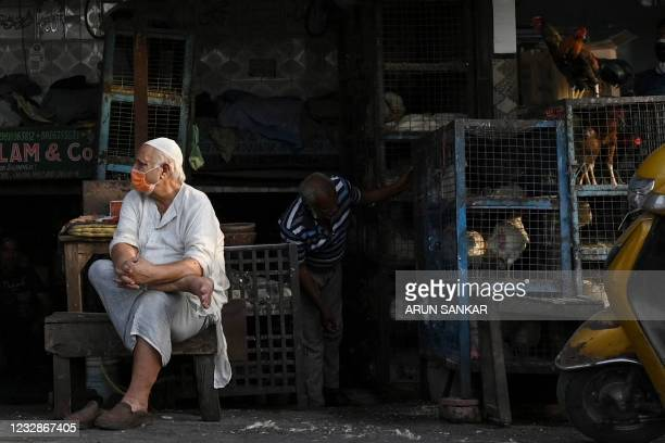 Poultry vendor wait for customers at a market during of Eid-Al- Fitr in the old quarters of New Delhi on May 13, 2021.