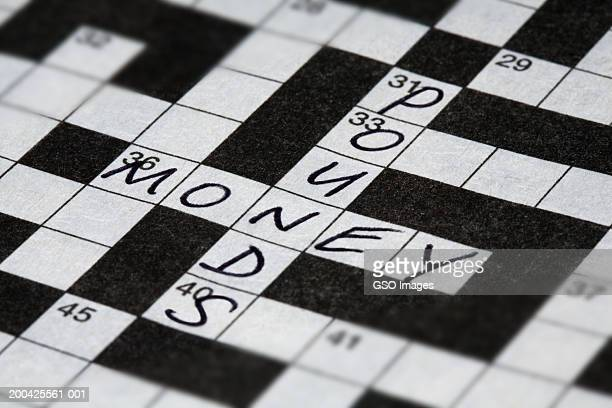 'Pound' and 'money' written on crossword, close-up
