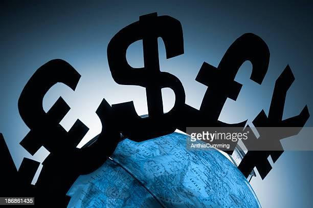 Pound, dollar and Yen Financial symbols around globe