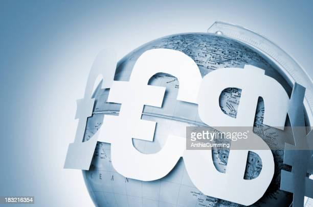 Pound, Euro, dollar and Yen symbols around globe