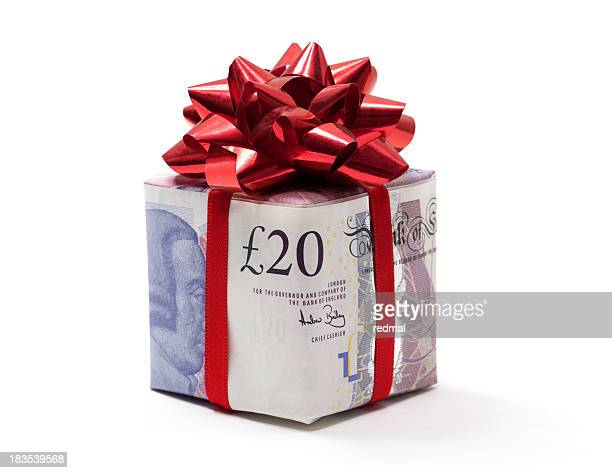 pound gift - pound sterling note stock photos and pictures