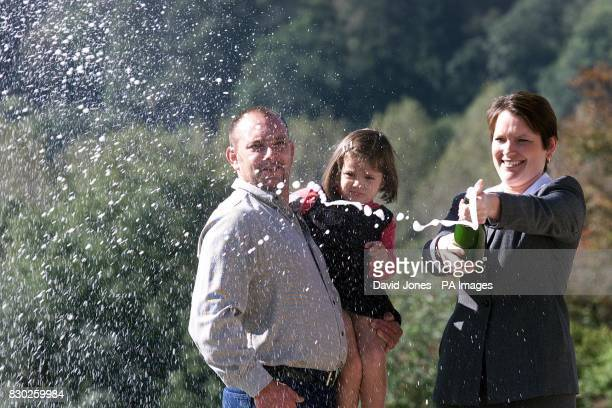 72M pound Lottery winner Stephanie Powell a bingo caller from Ebbw Vale celebrates with boyfriend Wayne Lawrence and their daughter 3 yr old Jessica...