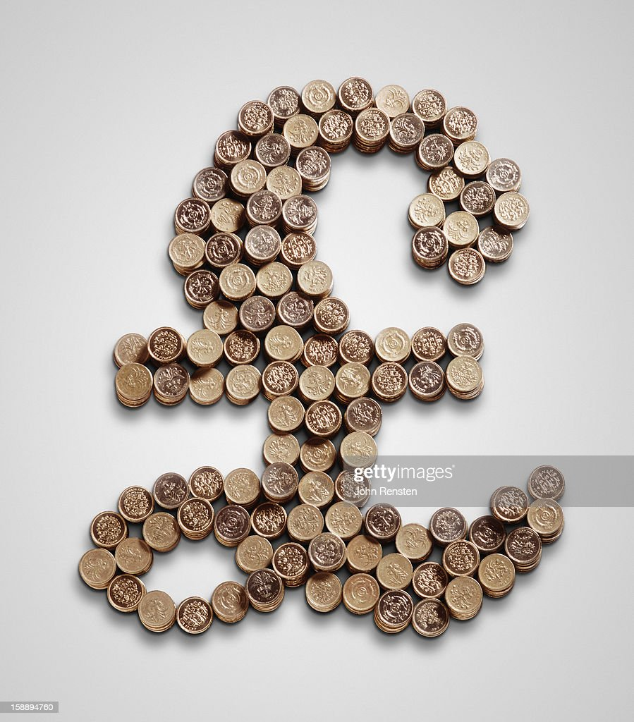 A pound sign made of pound coins : Stock Photo