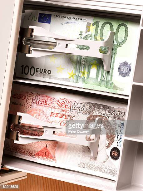 Pounds and Euros in cash register.
