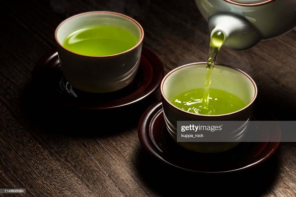 Pour green tea : Stock Photo