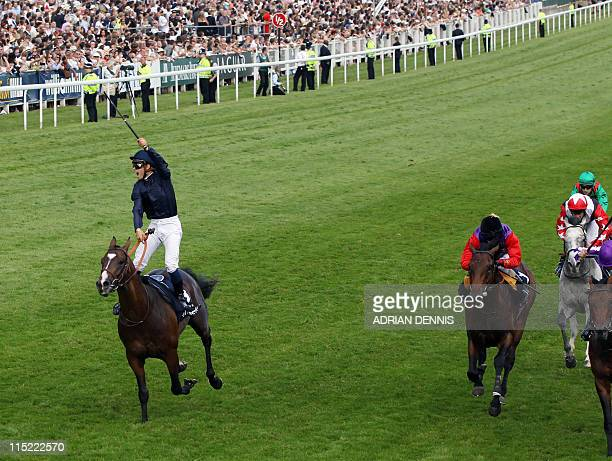 Pour Moi ridden by Jockey Mickael Barzalona passes the finish line to win The Investec Derby followed by Treasure Beach in second and Carlton House...