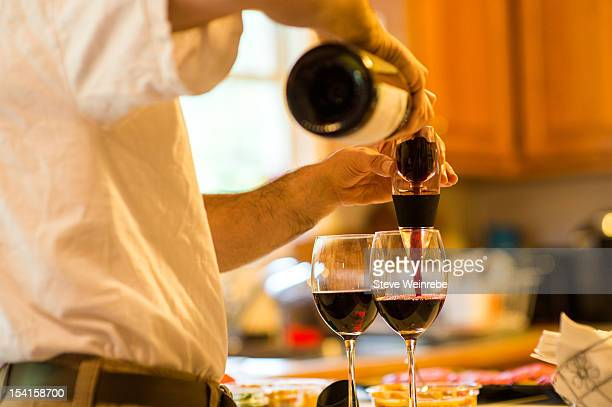 Pourimng red wine through a wine aerator