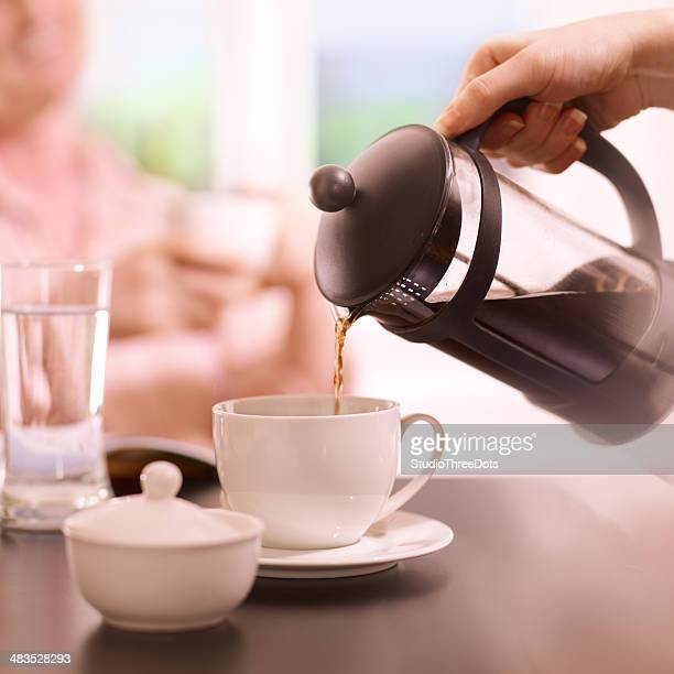 pouring a coffee from French press