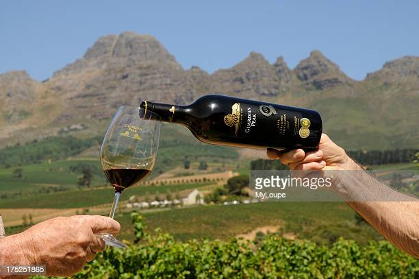 Pouring a glass of Cabernet Sauvignon wine from the bottle The wine produced by Ernie Els Wines seen here in the Helderberg Mountain foothills near...