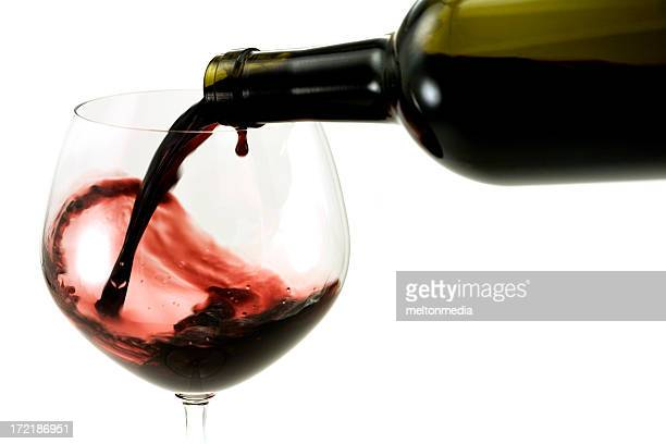 pouring a glass of red wine - cabernet sauvignon grape stock photos and pictures