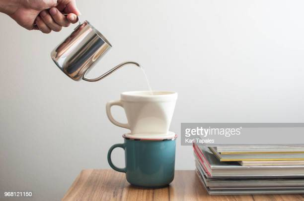 Pouring a hot water over a drip coffee