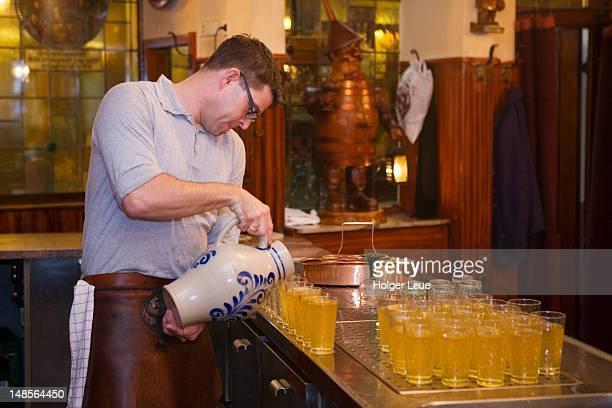 Pouring apple wine at Zum Gemalten Haus Restaurant in Sachsenhausen.