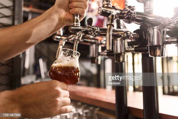 pouring beer for sutomer - pump dress shoe stock pictures, royalty-free photos & images