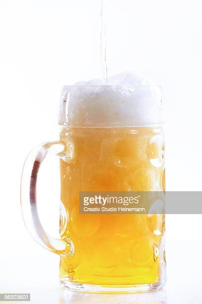 pouring beer into glass, close-up - beer stein stock photos and pictures