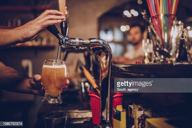 pouring beer - pub stock pictures, royalty-free photos & images