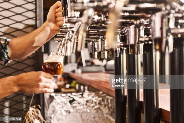 pouring beer - pump dress shoe stock pictures, royalty-free photos & images