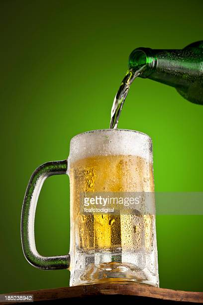 pouring beer - beer stein stock photos and pictures