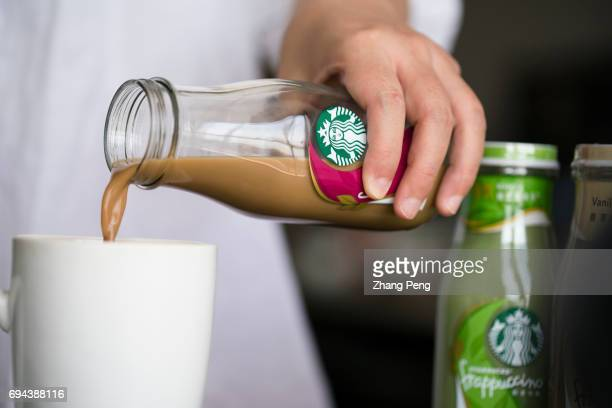 Pouring blacktea taste Starbucks bottled Frappuccino into a coffee cup In the first quarter of 2017 targeting to the Chinese consumers Starbucks...