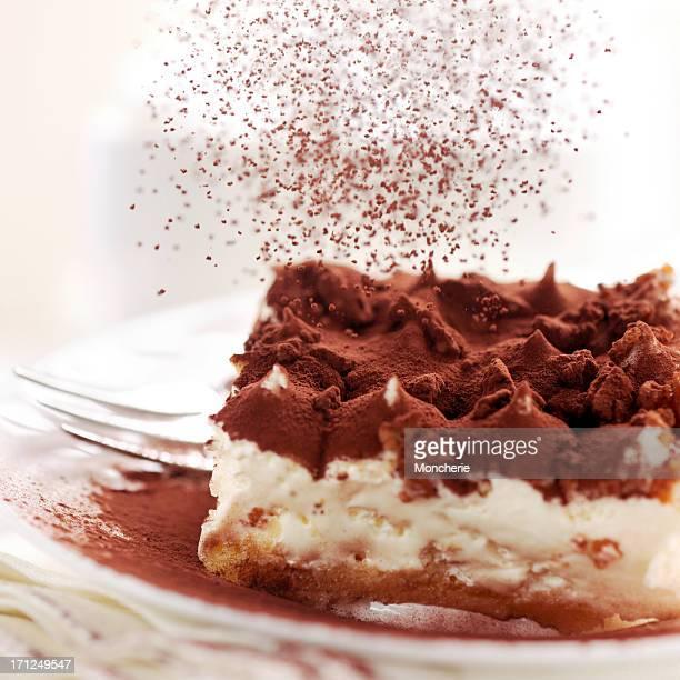 Pouring cacao powder to tiramisu