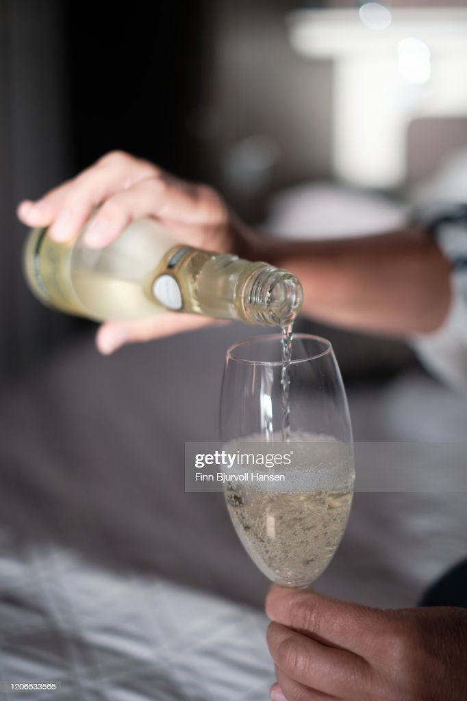 Pouring champagne into a glass closeup : Stock Photo
