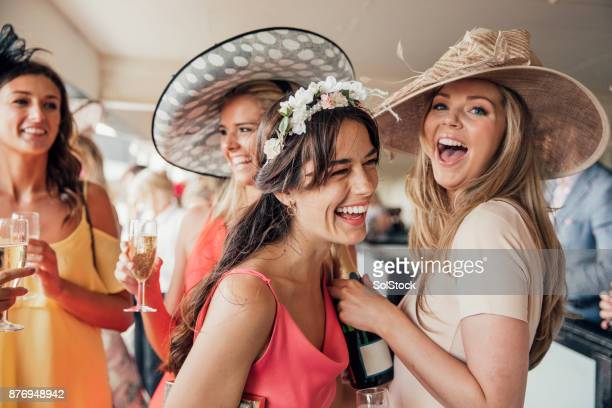 pouring champagne with friends - horse racing stock pictures, royalty-free photos & images