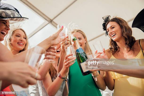 Pouring Champagne with Friends