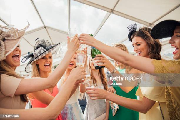 pouring champagne with friends - newcastle races stock photos and pictures