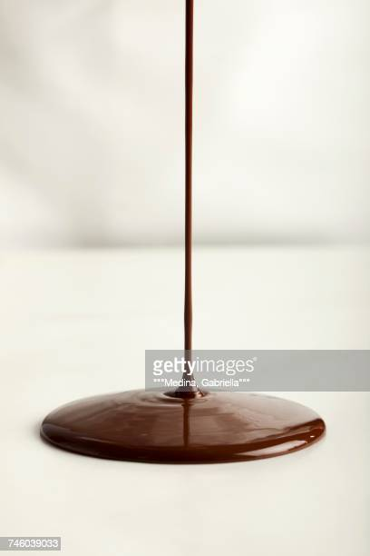 Pouring chocolate onto a flat surface