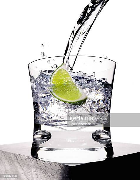 Pouring club soda with lime