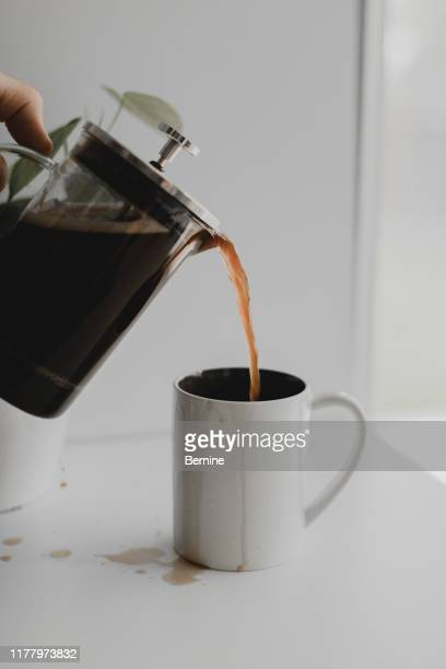 pouring coffee and spilling - caffeine stock pictures, royalty-free photos & images