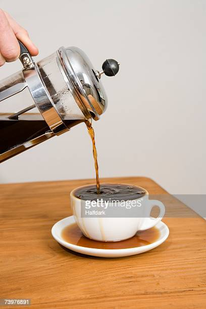 pouring coffee from a cafetiere - overflowing stock pictures, royalty-free photos & images