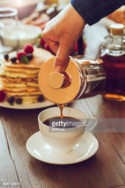 Pouring Coffee into Coffee Cup For Breakfast