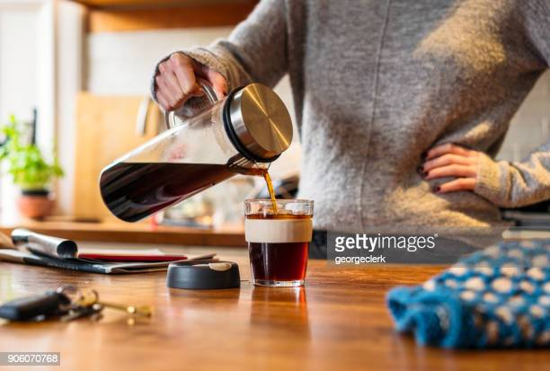 Pouring cold brew coffee at home