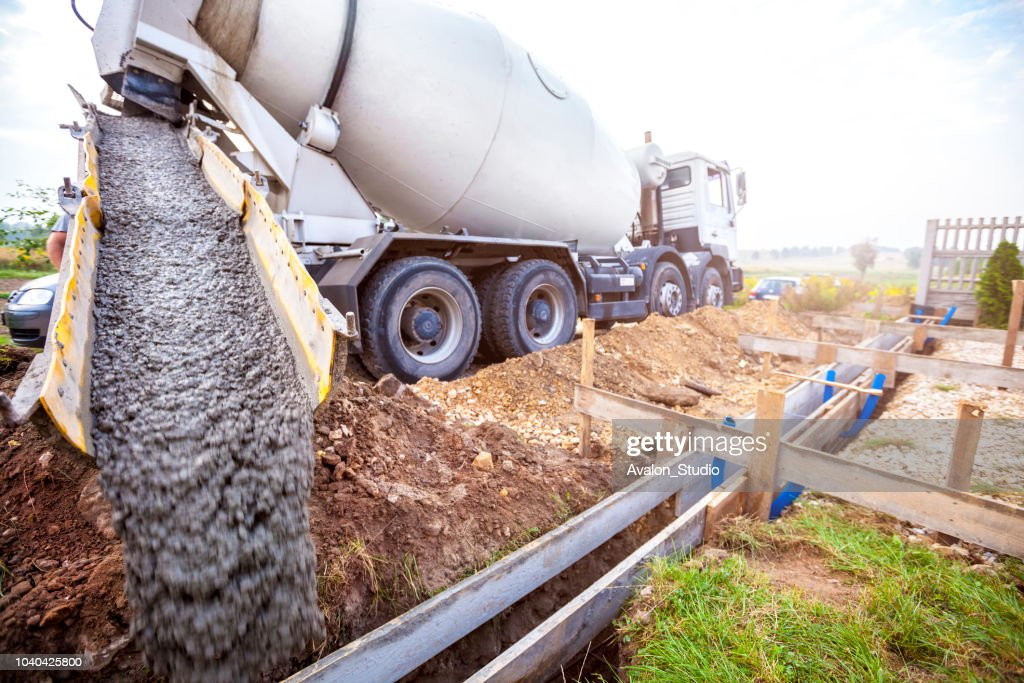 Pouring concrete to the foundations of the building : Stock Photo