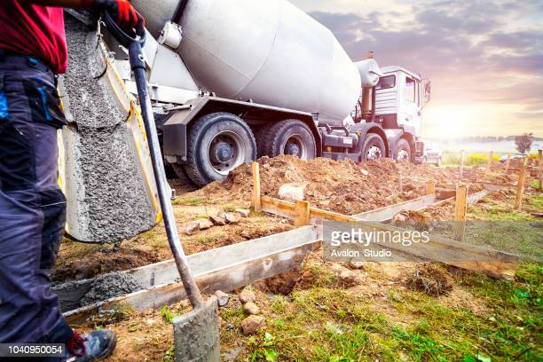 Pouring concrete to the foundations of the building