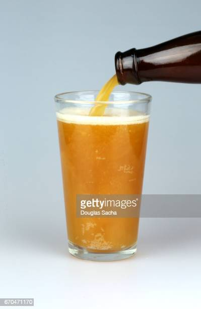 Pouring craft beer in a serving glass