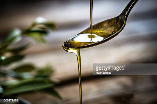 pouring extra virgin olive oil - olive oil stock pictures, royalty-free photos & images