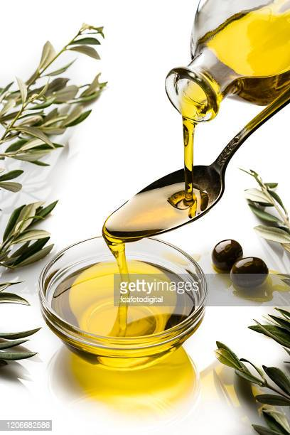 pouring extra virgin olive oil - extra virgin olive oil stock pictures, royalty-free photos & images