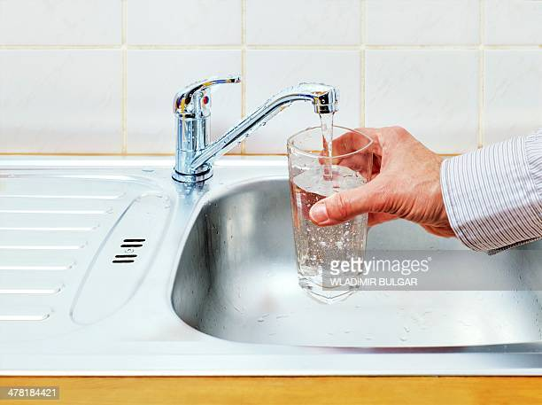 Pouring glass of tap water