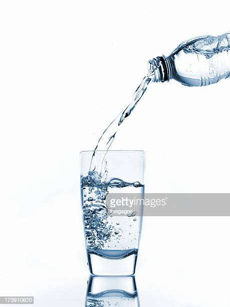 pouring glass of water - dump stock photos and pictures