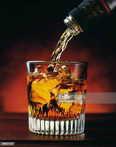 pouring glass of whiskey - whiskey stock pictures, royalty-free photos & images